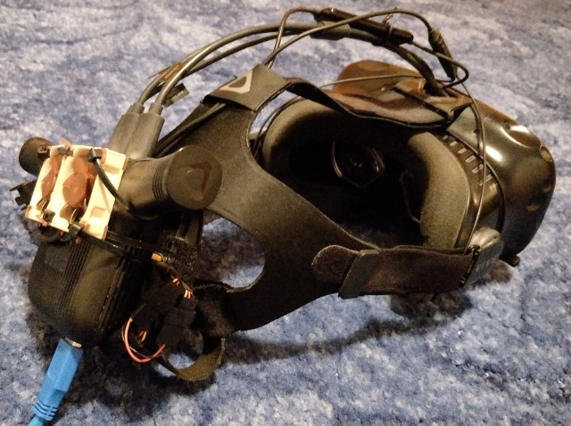 HTC Vive headset with Vive Wireless Adapter and two 40mm fans held on with cable ties